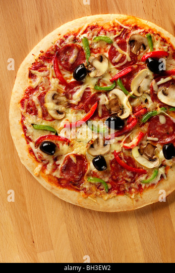 Pizza on a worktop - Stock Image