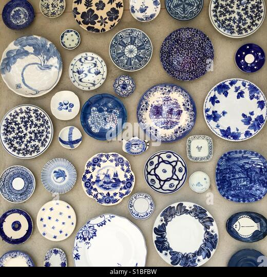 Dishes as the wall decoration - Stock Image