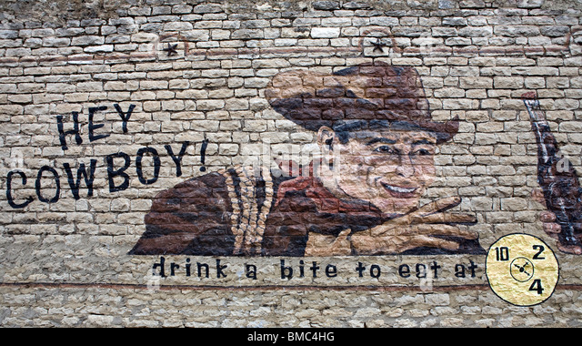 Mural painting advertizing Dr Pepper soft drink in Dublin, Texas. - Stock Image