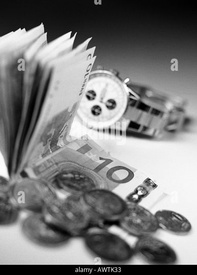Money and watch, close-up - Stock Image