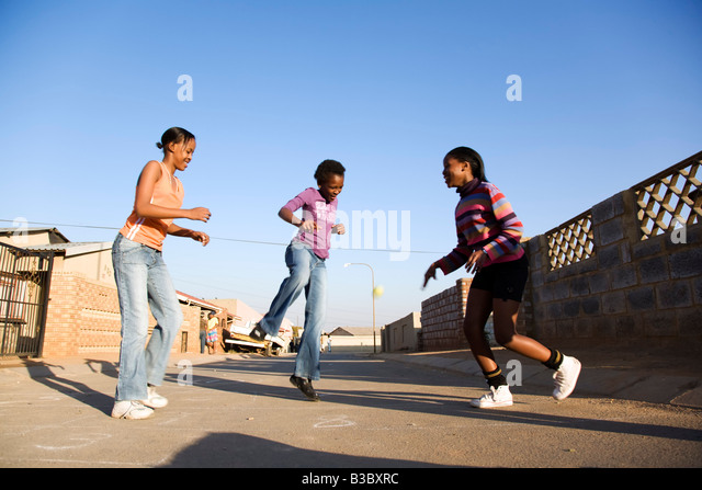 Girls playing on street - Stock-Bilder