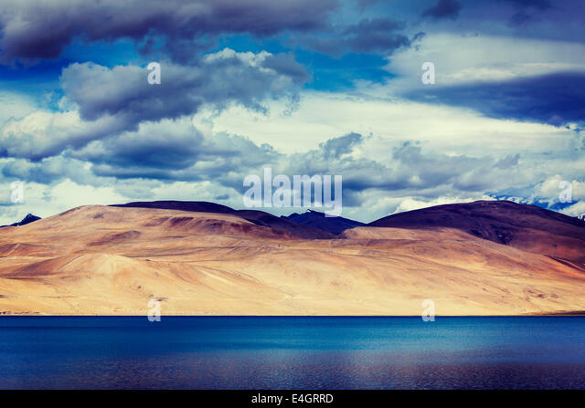 Vintage retro effect filtered hipster style travel image of Himalayan mountain lake in Himalayas Tso Moriri - Stock Image