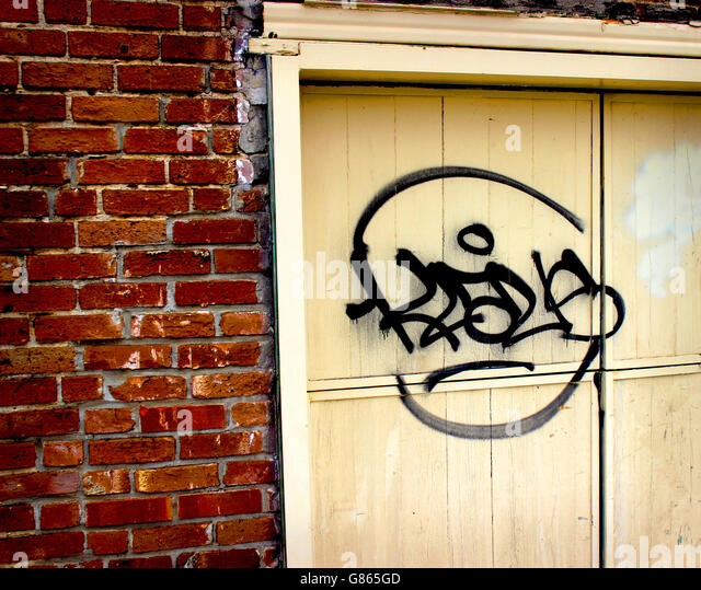 A door, a wall, and Graffiti - Stock Image