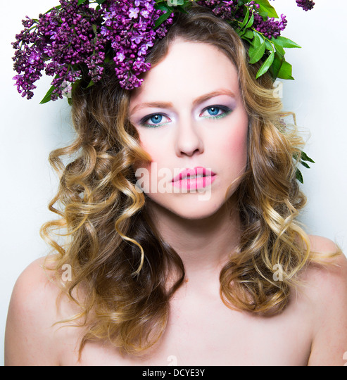 Young Woman with Purple Flowers on Head - Stock Image