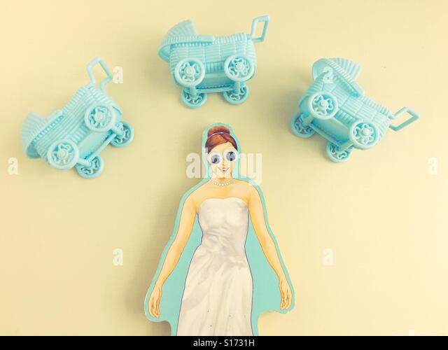 A cutout of a woman with big eyes, dreaming of babies. - Stock Image