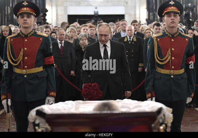 Moscow, Russia. 22nd Dec, 2016. Russia's President Vladimir Putin (C) pays last respects to Russian Ambassador - Stock Image