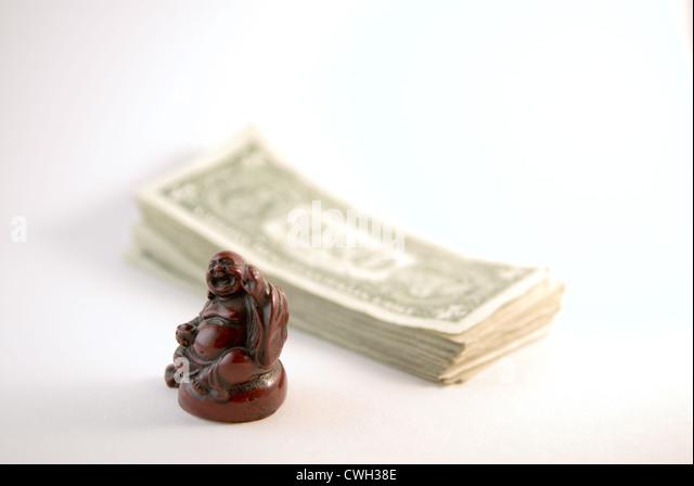 Buddha & Money - Stock Image