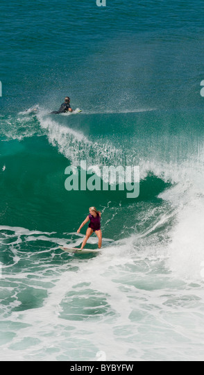 Soul Surfer Bethany Hamilton slips under a curling wave. - Stock Image