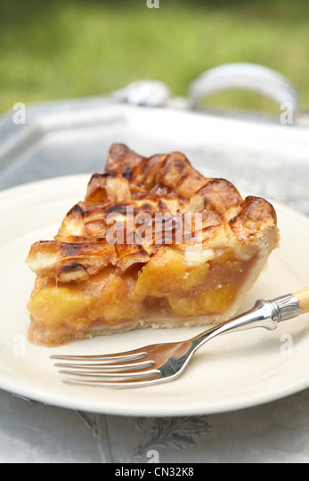 Slice of peach pie on plate - Stock Image