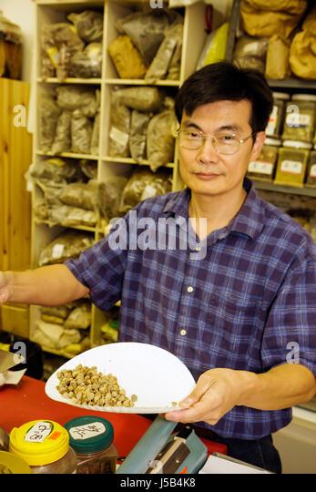 Orlando Florida Colonial Drive Little Vietnam Health Food City Asian man store shop alternative medicine ethnic - Stock Image