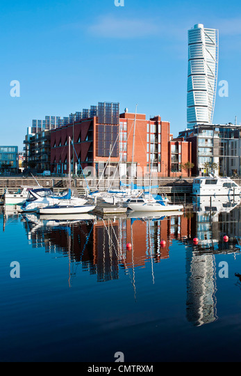 Moored boats and buildings against clear sky - Stock-Bilder