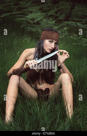 Beautiful wild huntress in the forest. Outdoor and ethnic - Stock-Bilder