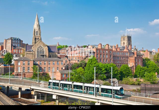 Nottingham tram crossing a bridge travelling from Nottingham city centre Nottinghamshire England UK GB EU europe - Stock Image