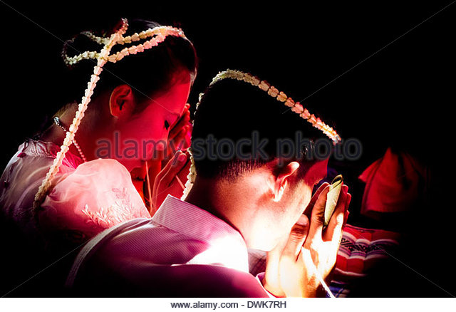 A traditional Buddhist wedding ceremony, in the Chaiyaphum province of North East Thailand, South East Asia. - Stock Image