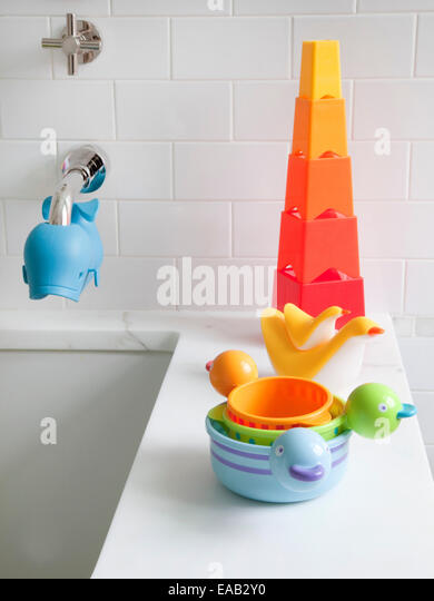 child's bath toys on the edge of bath tub at home - Stock-Bilder