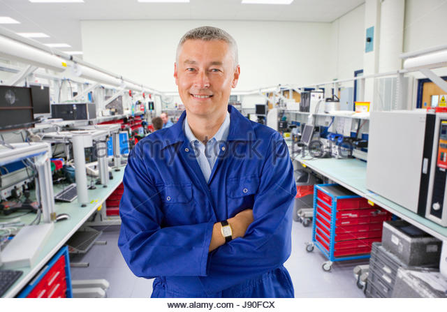 Technician On Factory Floor Of Electronics Plant - Stock-Bilder