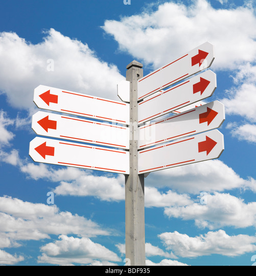 Direction signpost over blue sky - Stock Image