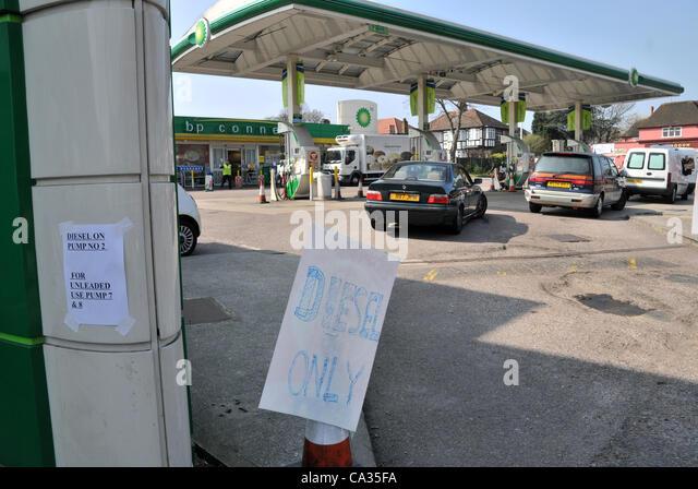 Petrol diesel pumps stock photos petrol diesel pumps for Garage attenant
