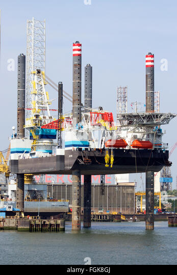 Self Elevating Platform JB-118 docked in the Port of Rotterdam. The rig is build in 20 - Stock Image