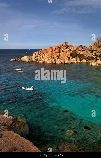 Italy Sardinia Capo Testa Cala Spinosa bay with cristal clear water surrounded by bizarre rocks - Stock Image