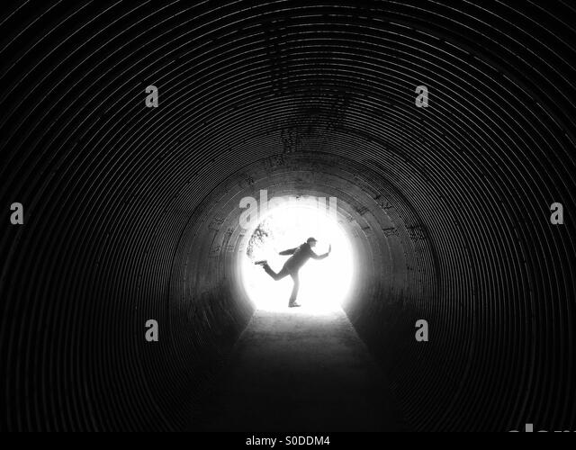 Man posing in tunnel - Stock Image