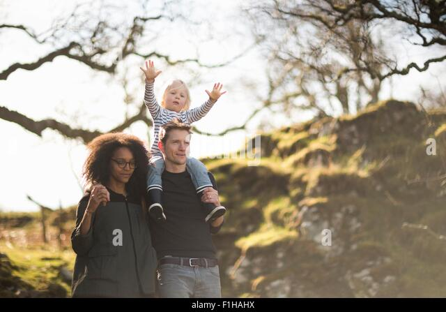 Family on walk, father carrying son on shoulders - Stock-Bilder