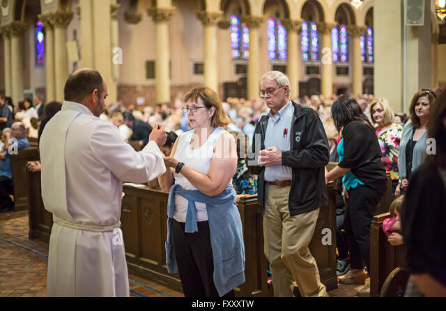 Detroit, Michigan - Communion during Sunday mass at Most Holy Redeemer Catholic church. - Stock Image