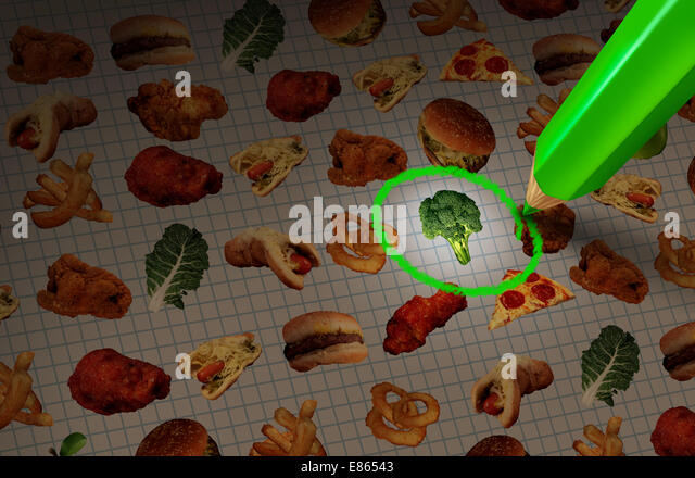 Healthy food choice diet and dieting concept as a menu chart with healthy and unhealthy meal choices with a pencil - Stock Image