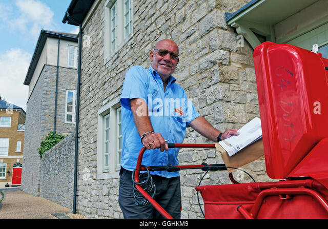 Postman in Poundbury, Dorchester, Dorset, England, Great Britain - Stock Image