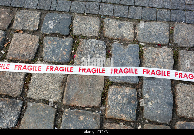 Fragile line on pavement - Stock Image