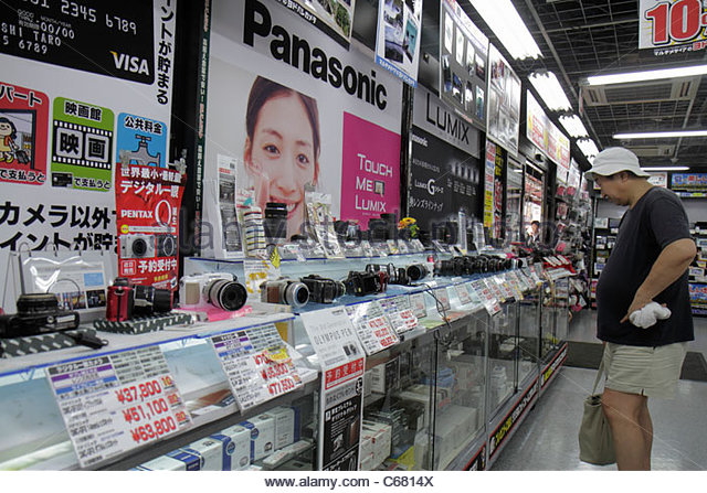 Japan Tokyo Shinjuku business electronics store digital cameras display for sale competing brands Panasonic Pentax - Stock Image