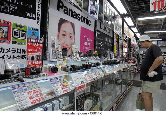 Tokyo Japan Shinjuku business electronics store digital cameras display for sale competing brands Panasonic Pentax - Stock Image