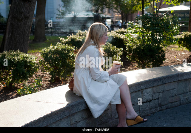Relaxing after the work. Drinking coffee in the street. NEW YORK, Union Square subway. Between the 14th and 17th - Stock Image