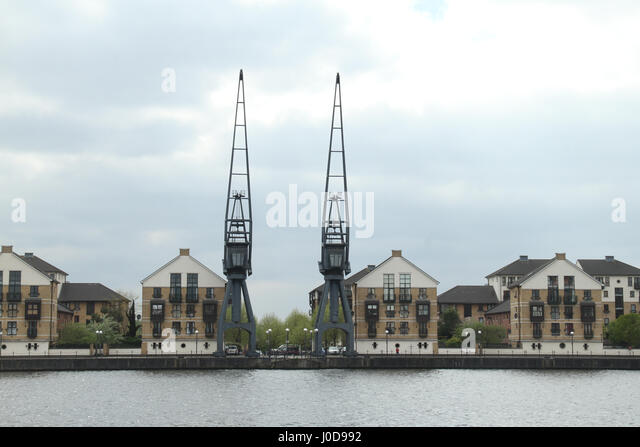 London, UK. 12th Apr, 2017. London, United Kingdom - April​ ​12: Cranes and residential houses at the Royal Victoria - Stock Image