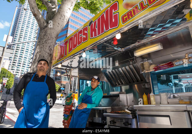 California CA Los Angeles L.A. Downtown business district street scene Hope Street hot dogs vendor food truck catering - Stock Image
