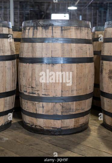Single Bourbon Barrel in Storage of whiskey distillery - Stock Image