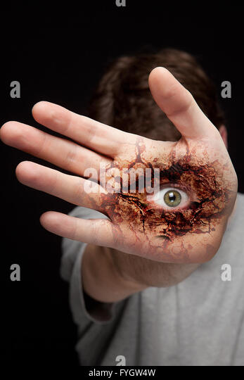 Hand with Spooky Scary Eye - Stock Image