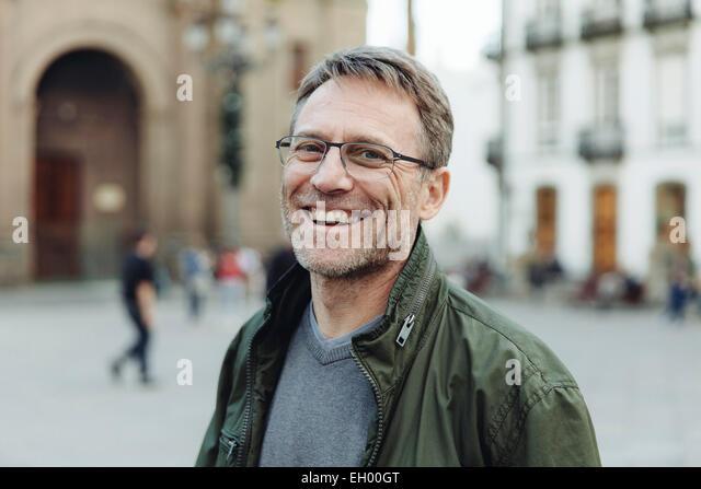 Spain, Canary Islands, Gran Canaria, Las Palmas, portrait of laughing mature man in front of Catedral de Santa Ana - Stock-Bilder