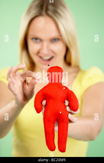 Woman Holding Voodoo Doll - Stock Image