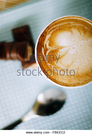 Cappuccino on a table at the bakery - Stock Image