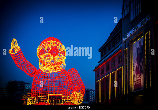 Germany, Berlin, lighted big sculpture of Father Christmas - Stock Image