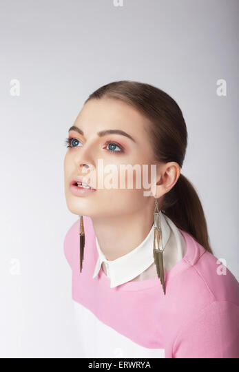 Attractive Young Female Looking Up - Stock Image