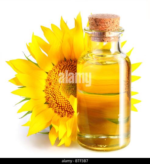 Bottle of sunflower oil with flower on a white background. - Stock-Bilder