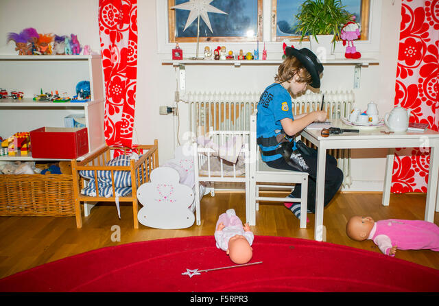 Sweden, Vastergotland, Lerum, Boy (6-7) writing in note pad - Stock Image
