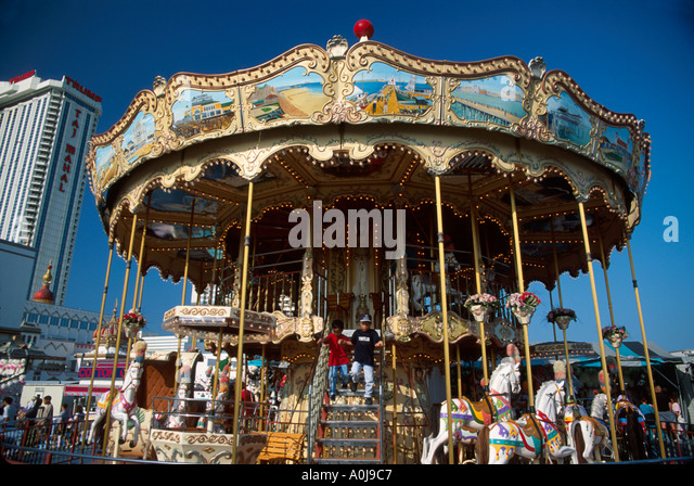 New Jersey Atlantic City Boardwalk Steel Pier Carousel Trump Taj Mahal Casino beyond - Stock Image