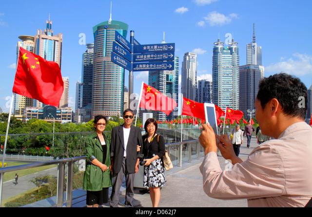 China Shanghai Pudong Lujiazui Financial District Lujiazui Pedestrian Bridge World Finance Tower China Merchants - Stock Image