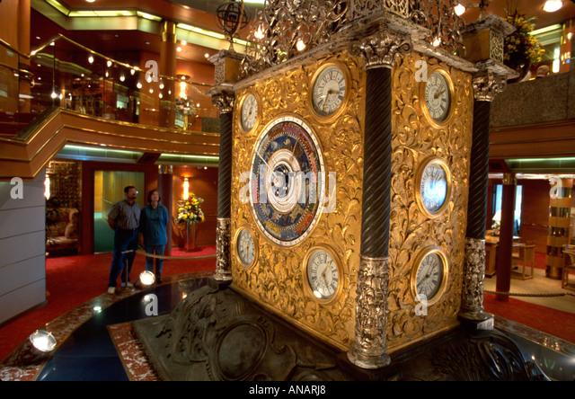 Italy Holland America Line ms Rotterdam cruise ship Atrium 14 clock centerpiece - Stock Image