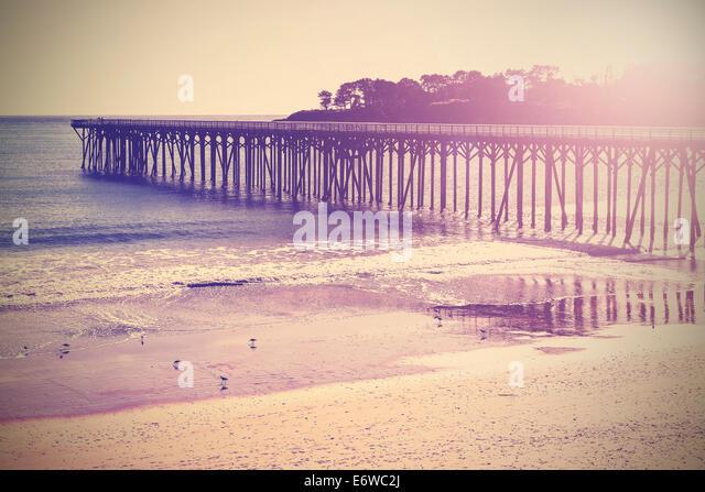 Vintage wood bridge at beach sunset, California, USA. - Stock-Bilder