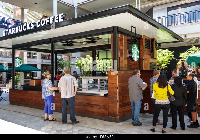 Hawaii Hawaiian Honolulu Ala Moana Center mall shopping Starbucks Coffee new location pre-opening inspecting company - Stock Image