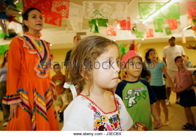 Miami Florida Miami Art Central Festival Mexico Miami Jalisco dress outfit Hispanic woman girl boy child children - Stock Image